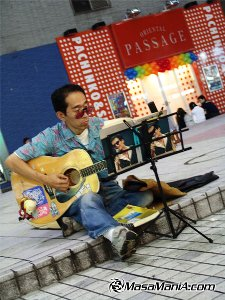 Photo of Street musician need strong vision as a musician in stead of sunglass