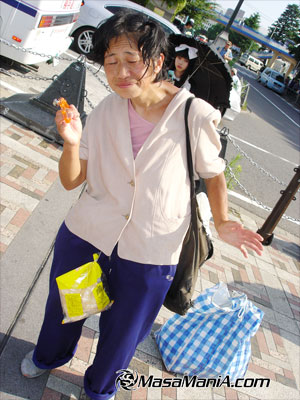 Photo of alla cappella street singer earning money by selling snack